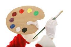 Mani delle Santa con la gamma di colori dell'artista immagini stock libere da diritti