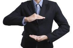Mani di affari nel gesto di protezione, cura Immagini Stock
