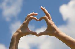 Mani di forma del cuore Fotografia Stock