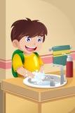 Mani di lavaggio del ragazzino Fotografie Stock Libere da Diritti