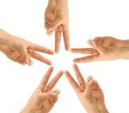 Mani di lavoro di squadra, formanti la figura della stella Immagine Stock