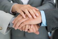 Mani di supporto Fotografia Stock