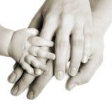 Mani di una famiglia Fotografie Stock Libere da Diritti