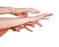 Mani disperate che raggiungono fuori Immagine Stock