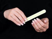 Mani e chiodi femminili Immagine Stock Libera da Diritti