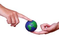 Mani e globo Immagine Stock