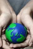 Mani e pianeta Immagine Stock Libera da Diritti