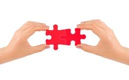 Mani e puzzle immagini stock