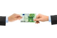 Mani e puzzle dei soldi Immagine Stock Libera da Diritti