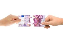 Mani e puzzle dei soldi Immagine Stock