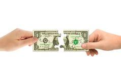 Mani e puzzle dei soldi Fotografia Stock Libera da Diritti