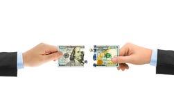 Mani e puzzle dei soldi Immagini Stock Libere da Diritti