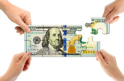 Mani e puzzle dei soldi Immagini Stock