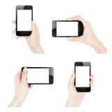 Mani femminili che tengono smartphone Fotografia Stock Libera da Diritti