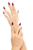 Mani femminili con le unghie rosse Fotografie Stock Libere da Diritti