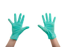 Mani in guanti chirurgici Fotografia Stock