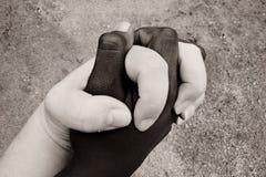 Mani insieme Immagini Stock