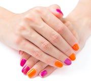 Mani luminose del manicure su fondo bianco Immagine Stock Libera da Diritti