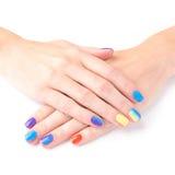 Mani luminose del manicure su fondo bianco Fotografia Stock
