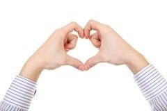 Mani nella forma del cuore Fotografia Stock