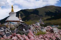 Mani pile and the white pagoda Stock Photos