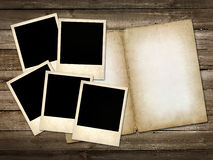 Mani Polaroid-style photo on the wooden background Stock Photos