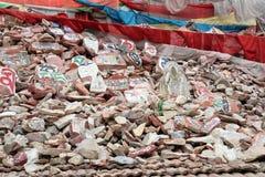 Mani rocks and prayer umbrella in Qinhai province Royalty Free Stock Image