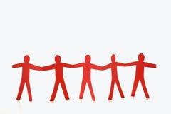 Mani rosse della holding della gente Fotografia Stock
