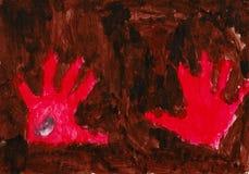 Mani rosse sui precedenti marroni Fotografia Stock Libera da Diritti