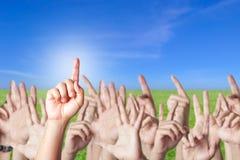 Mani sollevate insieme Fotografia Stock Libera da Diritti