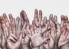 Mani sollevate verso l'alto immagine stock libera da diritti