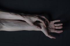 Mani sottili della morte Immagine Stock Libera da Diritti