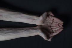 Mani sottili della morte Fotografia Stock
