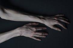 Mani sottili della morte Fotografie Stock
