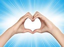 Mani sotto forma di cuore Immagine Stock