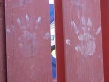 Mani sporche sul campo da giuoco Immagine Stock