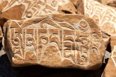 Mani Stone. Budhist symbols on Mani Wall in Zanskar Valley, Jammu and Kashmir, India Royalty Free Stock Images
