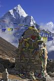 Mani stone in the Himalaya. There are Mani stone and Tibetian prayer flags on the way to the Everest Base Camp Stock Images