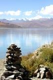 Mani stone on the lakeside Stock Image