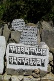 Mani Stones with Buddhist mantra in Himalaya, Nepal. Old Mani Stones inscribed with a Buddhist mantra in the Himalaya region, Nepal. Nepali color letters royalty free stock photos