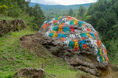 Mani Stones with Buddhist mantra in Himalaya, Nepal. Old Mani Stones inscribed with a Buddhist mantra in the Himalaya region, Nepal. Nepali color letters stock image