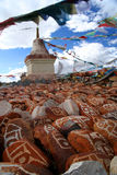 Mani stones and Buddhist stupa Stock Photography