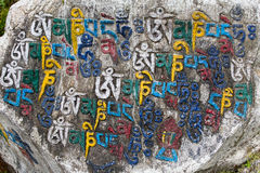 Mani stones with the inscription mantra is one of the elements of the Buddhist religion Stock Photos