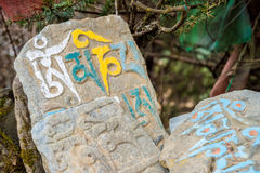 Mani stones with mantras. In Namche Bazaar, Nepal royalty free stock photo