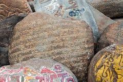 Mani stones. Om mani padme hum stones near tibetan monastery Royalty Free Stock Photo