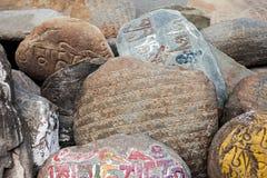 Mani stones. Om mani padme hum stones near tibetan monastery Stock Photography