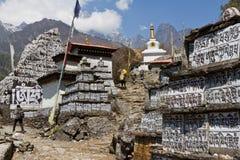 Mani stones. On the trek from Lukla to Namche Bazaar Stock Photography