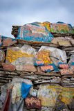 Mani Stones wall of Tibetan Buddhism stock photo