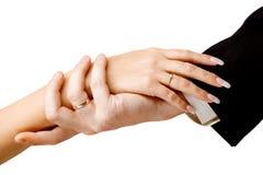 Mani sulla cerimonia nuziale Fotografie Stock