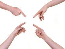 Mani umane che indicano il centro Fotografie Stock